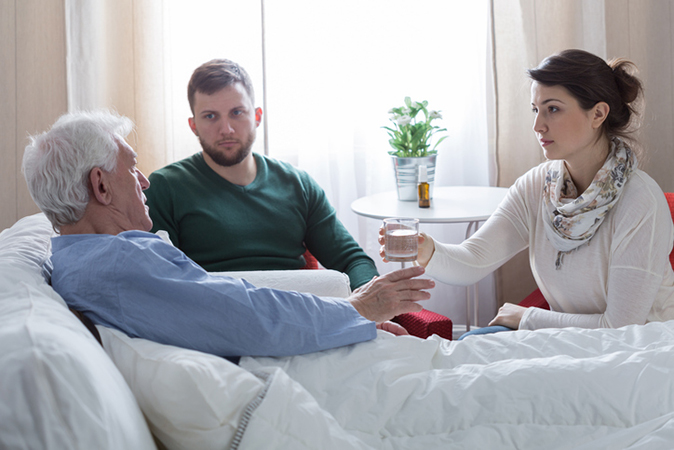 Patient in hospital with family